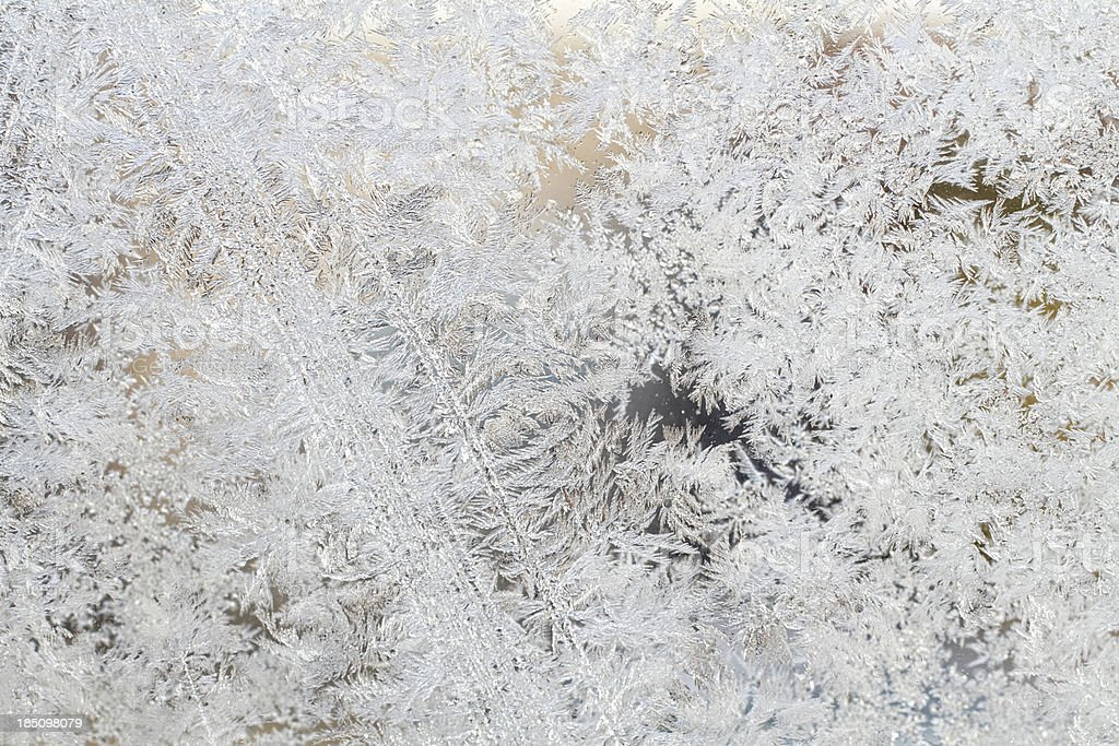 Ice crystals frozen pattern background on glass royalty-free stock photo