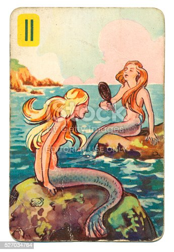 This is a Peter Pan playing card from British manufacturer Pepys with an illustration dating from 1939. Originally issued with green backs, this card is from a 1950s re-issue with red backs. The illustration shows two mermaids sitting on rocks.