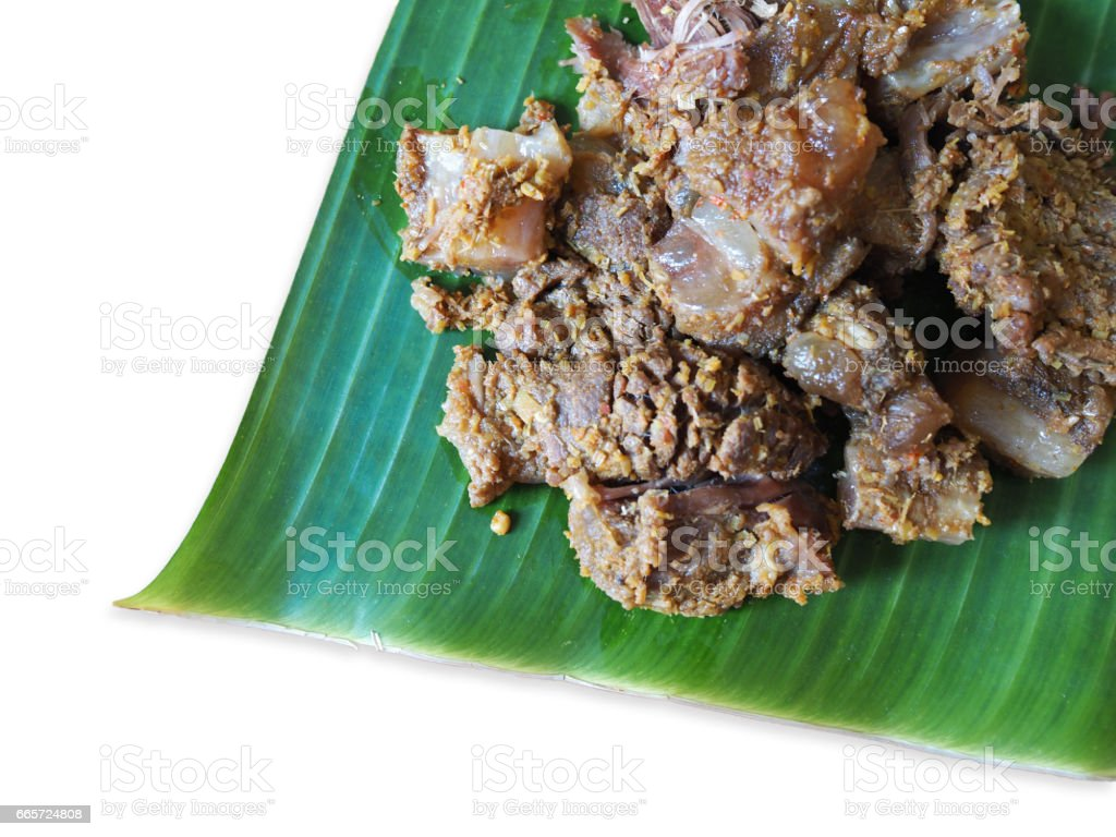 This is a steamed beef with  pound Thai berb on banana leaf stock photo