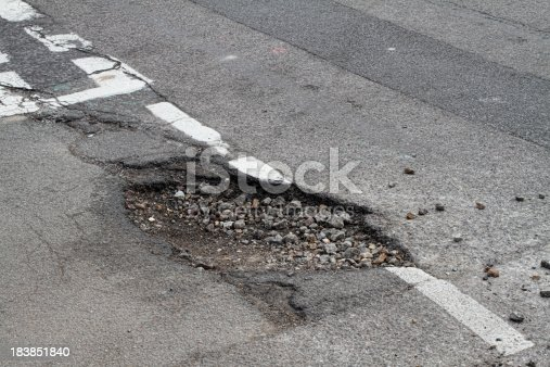 This is a T-junction in south London, and frost has done its work heaving up the surface in an area already weakened by previous road repairs. The aggregate stone beneath the surface is exposed and is scattering across the road. This sort of adverse frost action can take place place in two main ways. The first is frost heave, where ice forms below ground level and pushes the surface upwards. The second involves weakening of the substrate due to saturation of the under-surface as the ice melts.