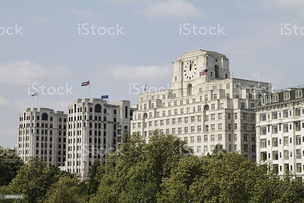Prominent buildings opposite River Thames South Bank in London stock photo