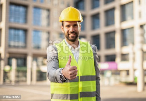Happy male Mid Adult Architect \ Engineer looking at camera and showing thumb up.