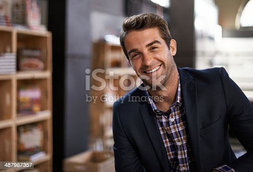 Portrait of a smiling young man in a restaurant