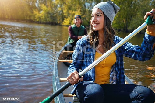 Shot of a young couple going for a canoe ride on the lake