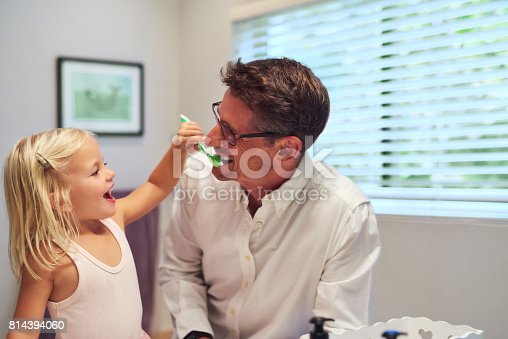 684029036 istock photo This is how you're supposed to brush, Dad 814394060