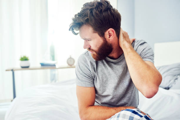 This is really painful Cropped shot of a young man experiencing neck pain human neck stock pictures, royalty-free photos & images