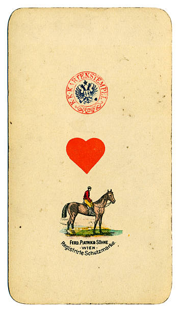 Ace of Hearts playing card Tarot Austrian Tarock 1900 This is the ace of Hearts from a pack of large Tarot cards (called Taroch or Tarok in German). Pip cards count as a fraction of one point in a game of tarot. Cards in this pack measure 74 x 129mm. This special card includes a picture of a horse and jockey together with the name Piatnik, the manufacurers based in Vienna. Also included is a tax stamp bearing the double-headed eagle with the number 44 in a shield. It is a nice, clear example of the tax stamp in use in Vienna in 1900. Austrian Taroch cards use French symbols (clubs, diamonds, hearts and spades), and a simplified pack numbering 54, which still includes the 21 trumps plus the fool. These make up the 22 'Taroch' cards. This particular pack was made by Piatnik (Vienna) in 1900. whiteway stock pictures, royalty-free photos & images