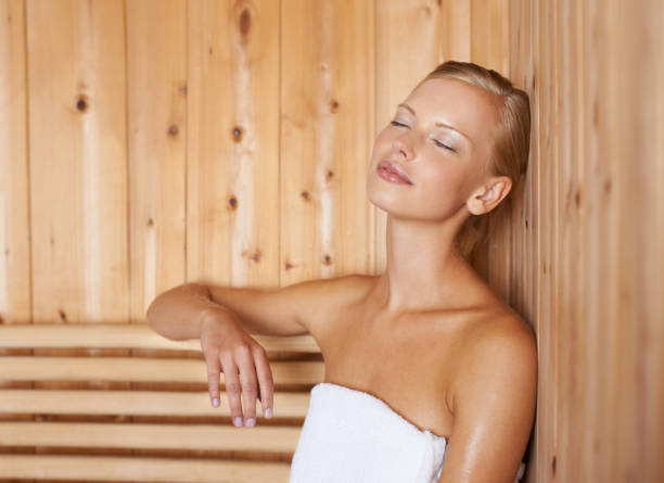 This is the life A gorgeous blond woman relaxing in a sauna sauna stock pictures, royalty-free photos & images