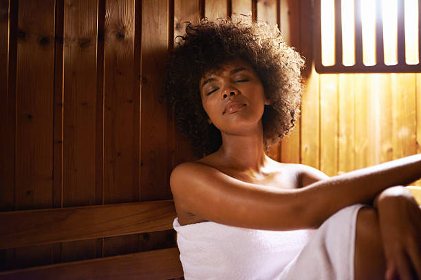 This is the life Shot of an attractive young woman relaxing in a sauna sauna stock pictures, royalty-free photos & images