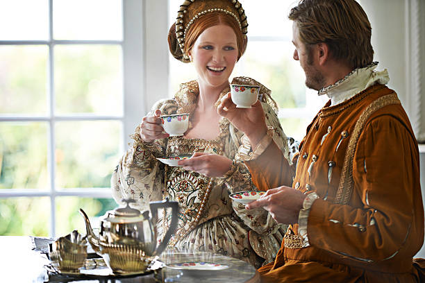 This is the most marvelous tea m'lady A king and queen taking tea together at home royalty stock pictures, royalty-free photos & images