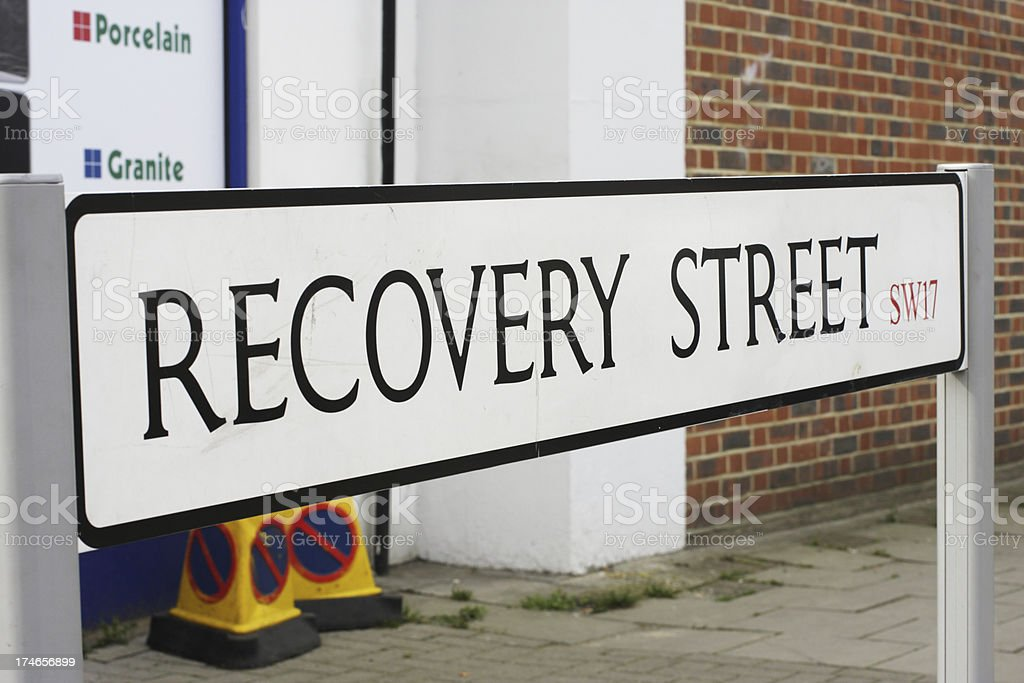 Recovery Street sign for the global economy or after illness stock photo