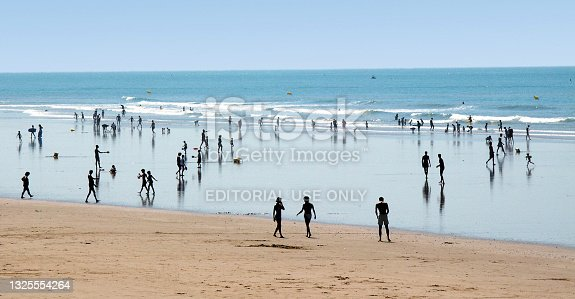 istock This is the tourist seaside resort of  Saint-Gilles-Croix-de-Vie  in the Vendée department, region of Pays de la Loire, Western France. It is a hot sunny day in summer and there are tourists and holidaymakers on vacation enjoying the sunshine. 1325554264