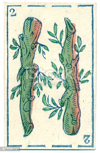 This is the two of clubs / batons (Bastos) from a pack of Mexican Spanish playing cards dated 1846. The distinctive back design is made up of an abstract repeating pattern. This card belongs to a baraja Espanola (Spanish deck of cards with a traditional design). The four suits are oros (gold coins), copas (cups or trophies), espadas (swords) and bastos (clubs or batons, shown here). A full deck consists of 40 cards because there are no 8s or 9s, and the first court card counts as 10 (not 11). Packs of this kind, based on the Italian card system, have been around since the 15th century. These club / baton designs are more life-like than in later representations (see example below). Clubs or batons (in Spanish (bastos)) are thought to represent the peasant class in mediaeval society. Baraja (Spanish decks) are also used like tarot cards in fortune telling / cartomancy / divination.