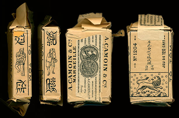 wrapper vietnamese to tom 3-suit money playing cards 1900 - whiteway money stock photos and pictures