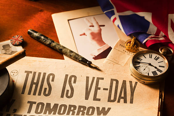"""This is VE Day """"Itaas Tuesday May the 8th 1945 and itaas VE Day - aEVictory in Europeaa Day for World War II. Winston Churchill broadcasts the news to the nation. Unconditional surrender was signed by Germany on the preceding day at the time displayed by the watch, 2.41pm."""" 20th century history stock pictures, royalty-free photos & images"""