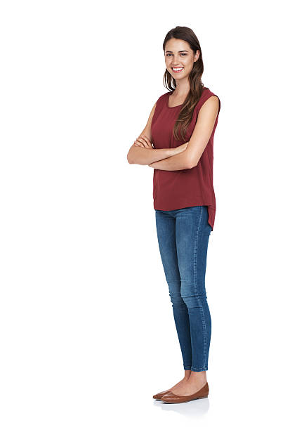 This is what confidence looks like Studio shot of a happy young woman isolated on whitehttp://195.154.178.81/DATA/i_collage/pu/shoots/805304.jpg skinny jeans stock pictures, royalty-free photos & images