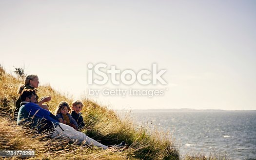 Shot of a young couple out on an adventure together with their two kids