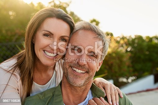 Cropped portrait of an affectionate mature couple standing outside