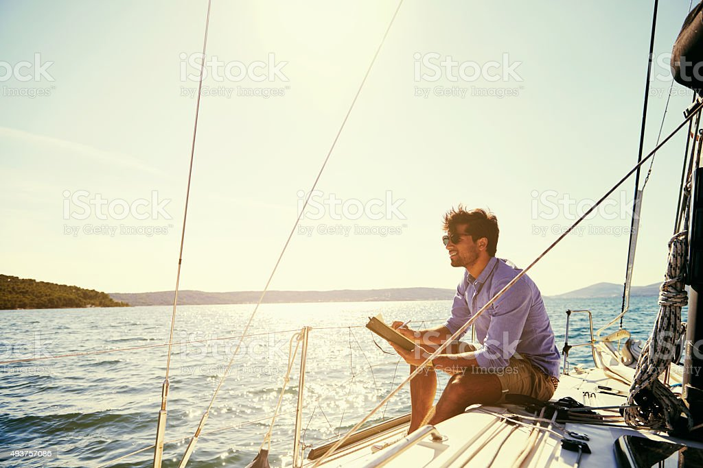 This is where he finds his inspiration Shot of a young man writing while out on his yachthttp://195.154.178.81/DATA/i_collage/pu/shoots/805773.jpg 2015 Stock Photo