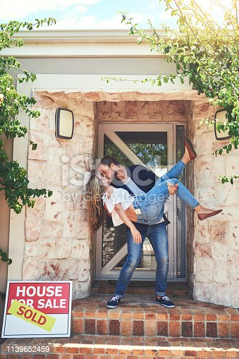 Shot of an affectionate young couple celebrating the move into their new home