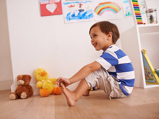 This little piggy went to the market... Shot of a little boy playing in his room touching toes stock pictures, royalty-free photos & images