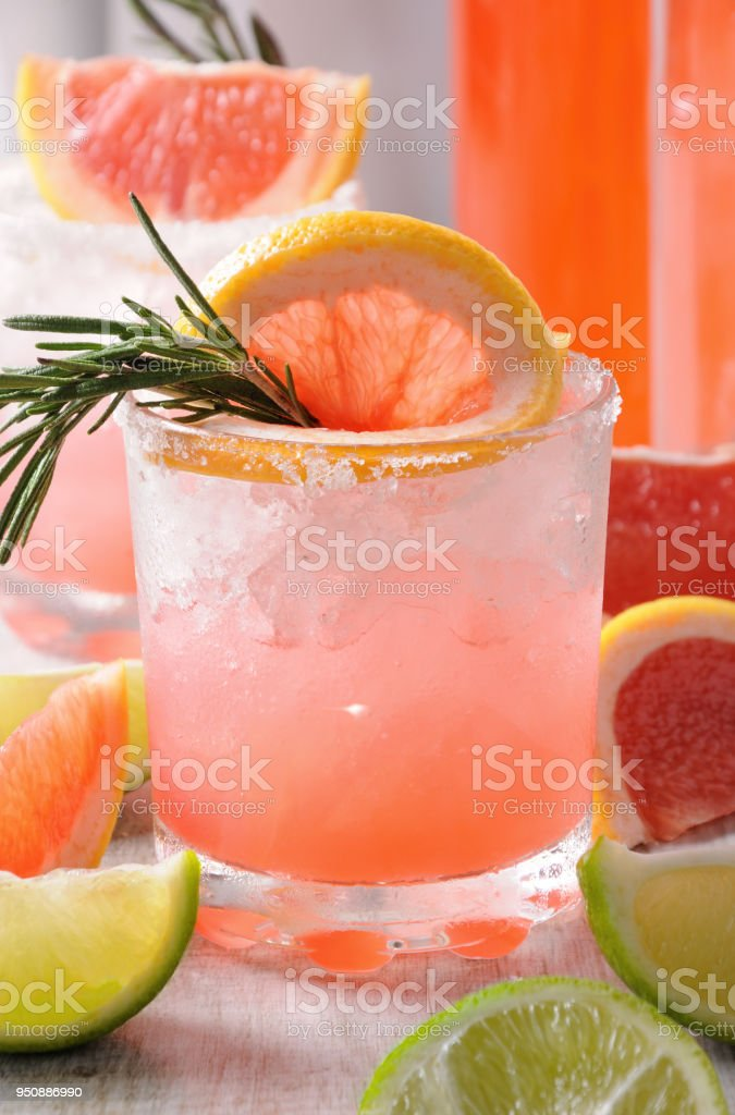 This magnificent cocktail of fresh pink Palomas stock photo