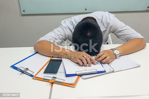 istock This man has many contracts and report to deal with 520876622