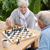 An elderly couple playing chess together outdoorshttp://195.154.178.81/DATA/shoots/ic_783134.jpg