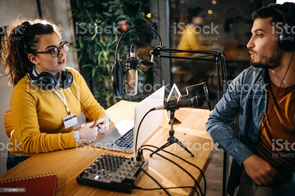 This night will be amazing in air Man and woman working on radio station, having talk show Adult Stock Photo