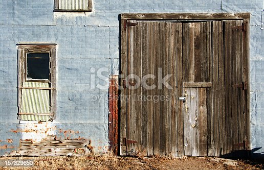 Dilapidated (but beautiful) old tin-sided garage with wooden door