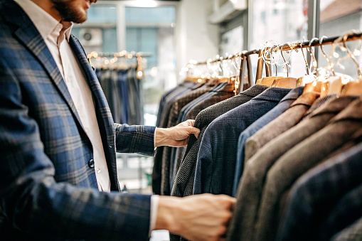 Businessman trying suit in store