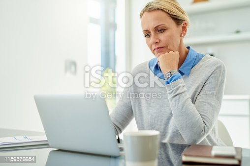 Cropped shot of an attractive mature businesswoman looking thoughtful while working in her home office