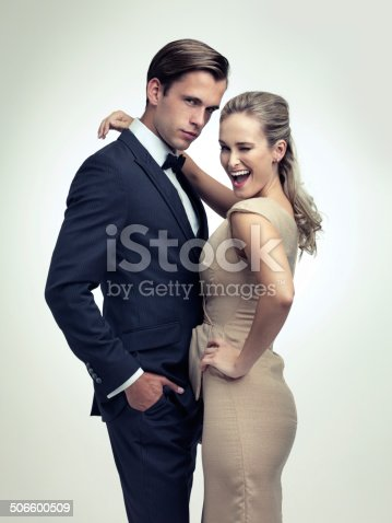 A studio portrait of a couple in stylish vintage evening wear