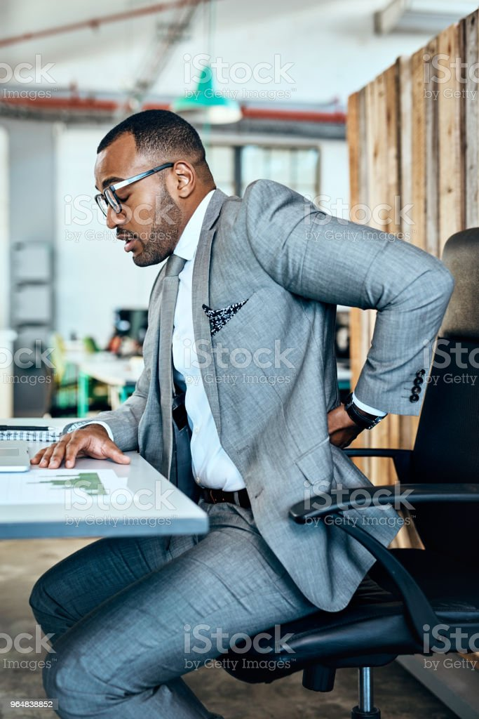 This pain is putting a damper on my productivity royalty-free stock photo