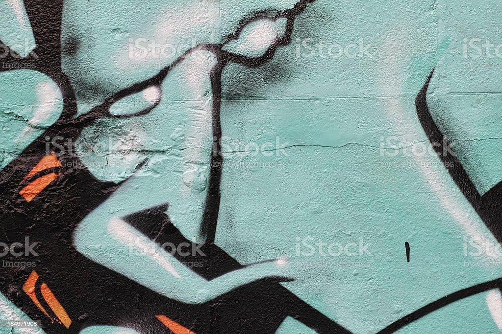 Green black graffti resembles evil eyes stock photo