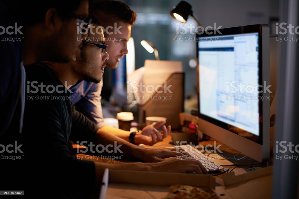 This problem is going to need everyone's imput Cropped shot of a group of young coworkers working in a dimly-lit officehttp://195.154.178.81/DATA/i_collage/pi/shoots/783867.jpg 20-29 Years Stock Photo