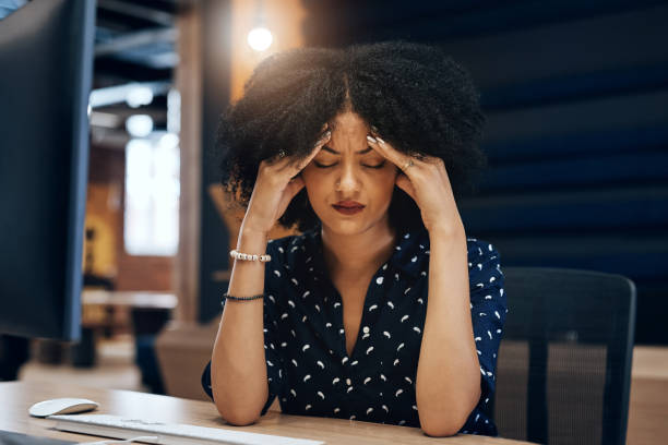 This project is just giving me a big headache Shot of a tired young female designer looking stressed with her hands in her hair while contemplating in the office at work headache stock pictures, royalty-free photos & images