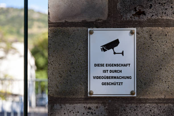 this property is protected by video surveillance - german sign - big brother orwellian concept stock pictures, royalty-free photos & images