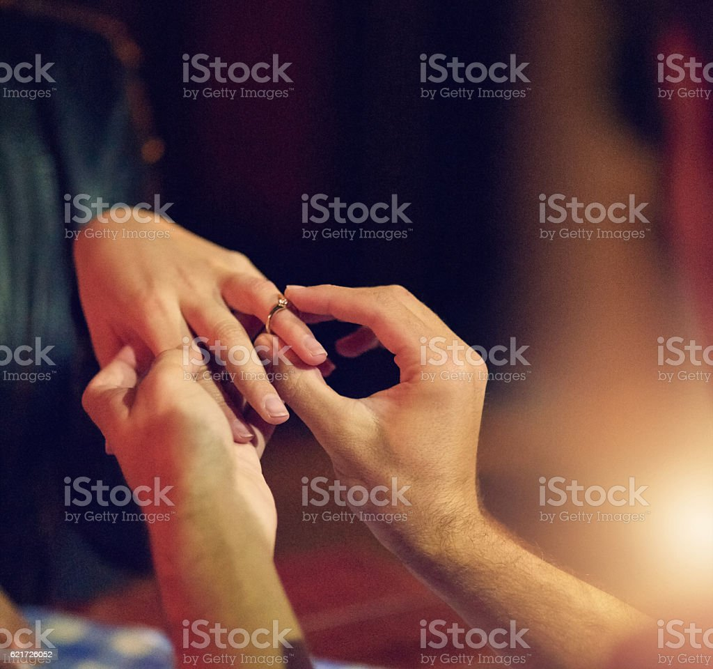 This ring is a symbol of my love and commitment stock photo
