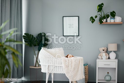 Still life shot of an empty crib in a nursery at home