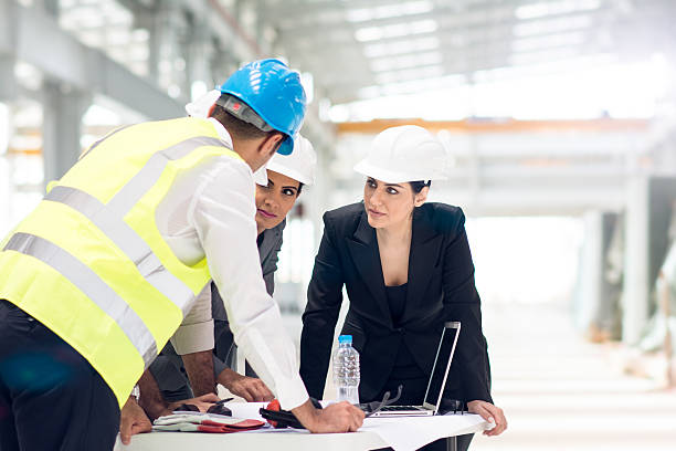 This seems like a good idea! Group of arabic architects and managers coordinating construction. project manager stock pictures, royalty-free photos & images