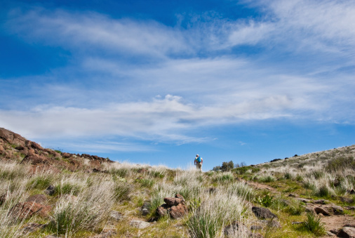 Hiker Reaches The Top Of Cowiche Ridge Stock Photo - Download Image Now