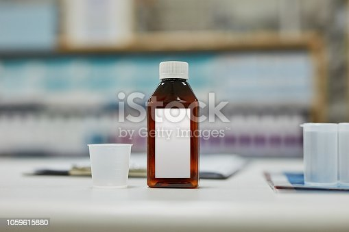 Shot of medicine on a pharmacy counter
