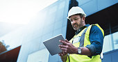 Shot of a engineer using a digital tablet on a construction site