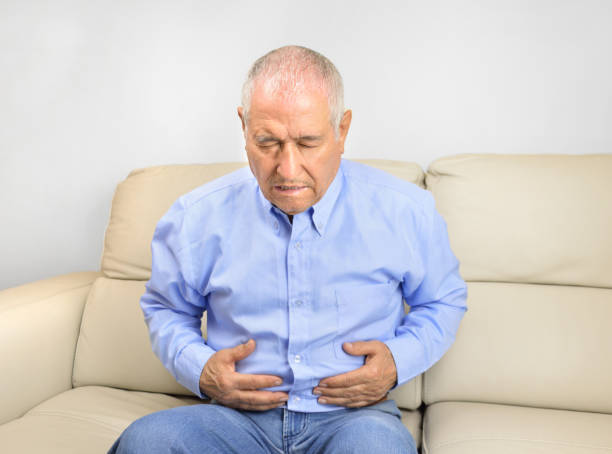 this stomachache is killing me stock photo