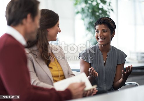 Shot of three businesspeople having a discussion in the office