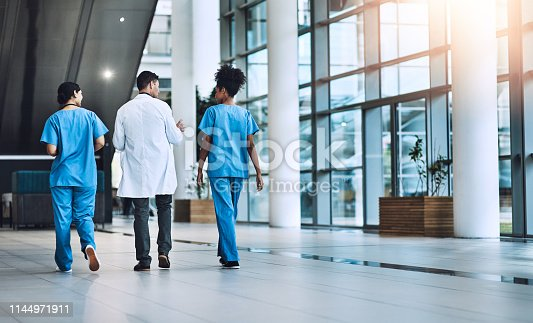 Shot of medical practitioners having a conversation in a hospital