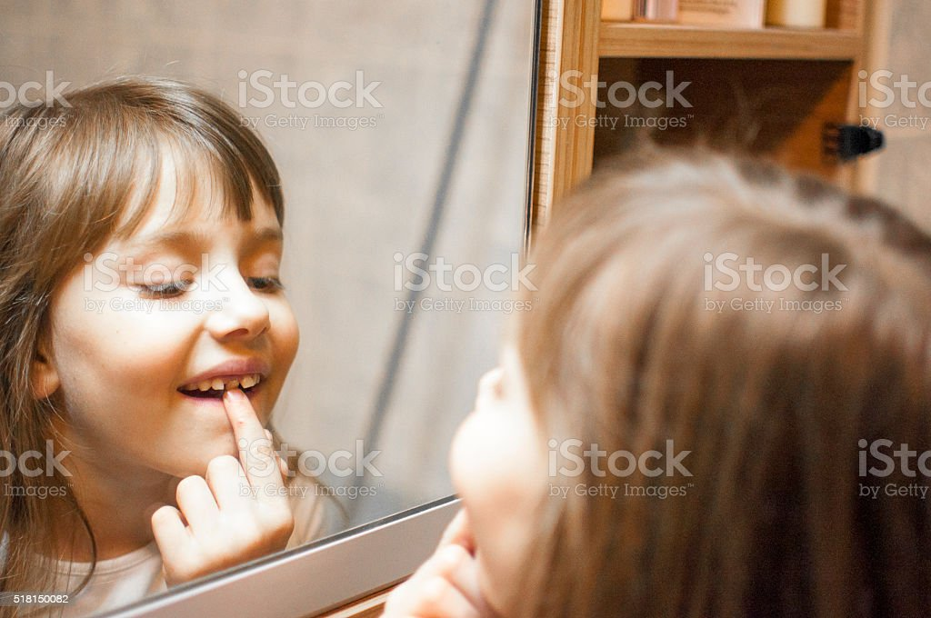 This tooth is going out stock photo