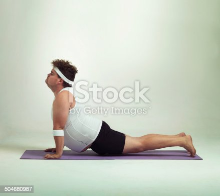 Shot of an overweight man doing yoga poses