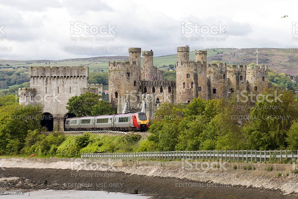 This Virgin Train in the welsh countryside passes a Castle stock photo